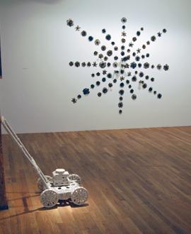 Susan                                               Graham at Schroeder                                               Romero-disaster show                                               installation