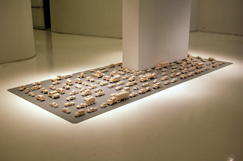 Susan                                               Graham porcelain car                                               sculpture installation